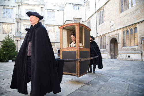 Lucy Worsley being carried in Westminster Chair