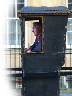 David Dimbleby riding in the speaker's sedan chair in Bath